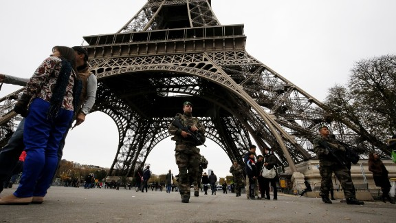 French soldiers patrol the area at the foot of the Eiffel Tow
