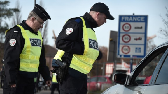 "French Police officers carry out checks on vehicles on the ""European bridge,"" between Strasbourg and Kehl, on November 14,  as part of security measures in the wake of attacks in and around Paris."