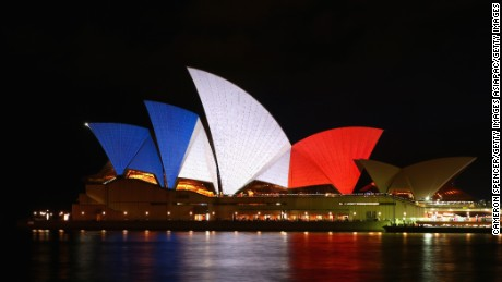 The Sydney Opera House is illuminated in the colors of the French flag.