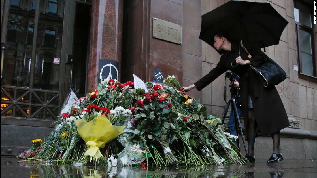 A woman places flowers in front of the French Consulate in St. Petersburg, Russia, on November 14.
