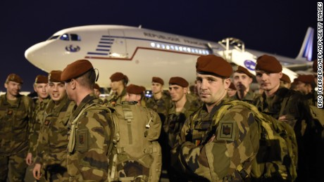 Soldiers from the 3rd Marine Infantry Parachute Regiment (3e RPIMa) of Carcassonne are pictured upon their arrival at Paris' Charles de Gaulle airport as part of a reinforcement of security provisions, following a series of coordinated attacks in and around Paris on November 14, 2015 in Roissy-en-France. Islamic State jihadists claimed a series of coordinated attacks by gunmen and suicide bombers in Paris that killed at least 128 people in scenes of carnage at a concert hall, restaurants and the national stadium. AFP PHOTO/ERIC FEFERBERGERIC FEFERBERG/AFP/Getty Images