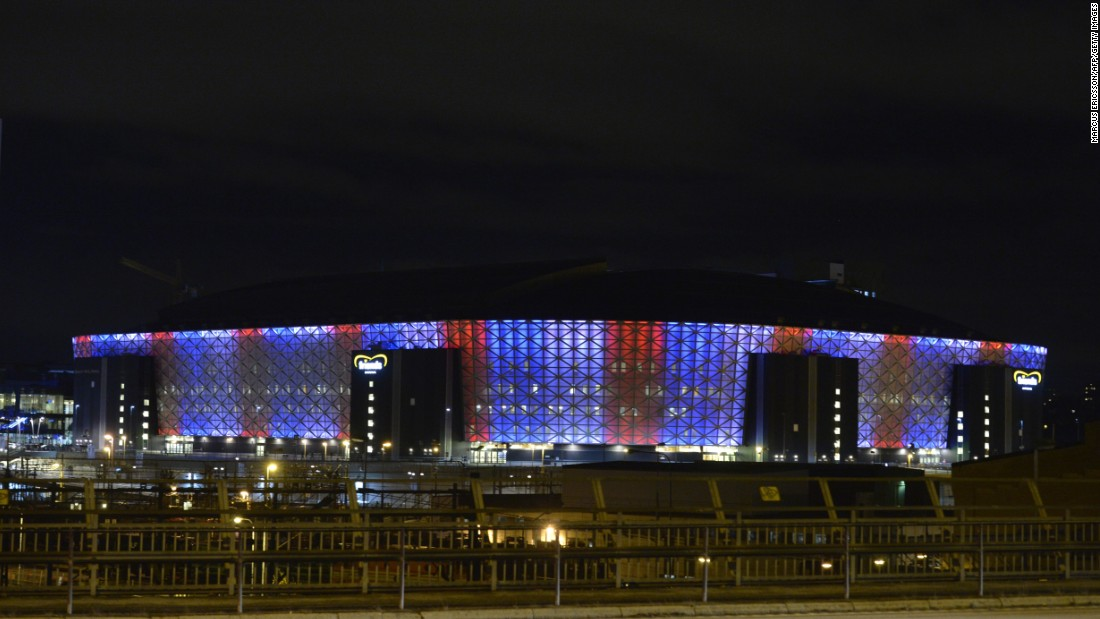 Friends Arena in Solna, Sweden, is illuminated in blue, white and red on November 14.