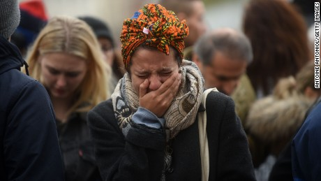 A woman weeps in Paris on November 14, the day after a series of deadly attacks in the French capital.