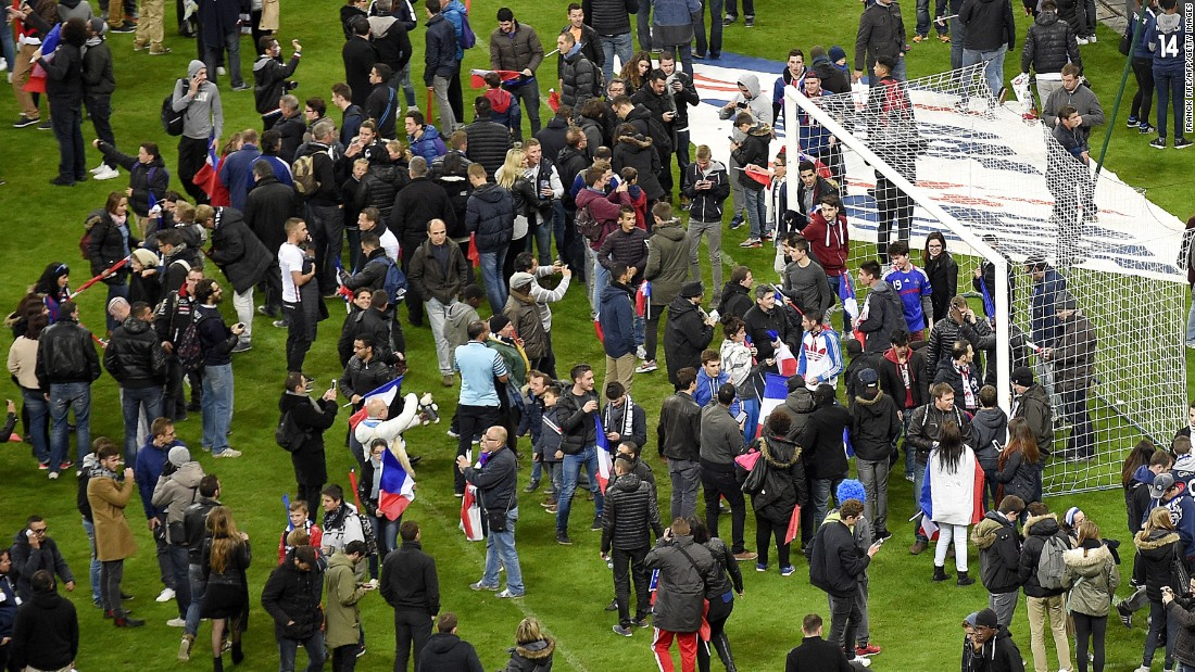 Fans at the France - Germany match were gathered on the pitch in the aftermath of explosions near the Stade de France. The match, won 2-0 by France, had been completed but people were held in the stadium for security reasons.
