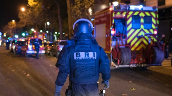 An elite police officer arrivesoutside the Bataclan theater  in Paris, France, Wednesday, Nov. 13, 2015. Several dozen people were killed in a series of unprecedented attacks around Paris on Friday, French President Francois Hollande said, announcing that he was closing the country