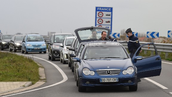Security personnel inspect vehicles at the border between Belgium and France on Saturday, November 14.
