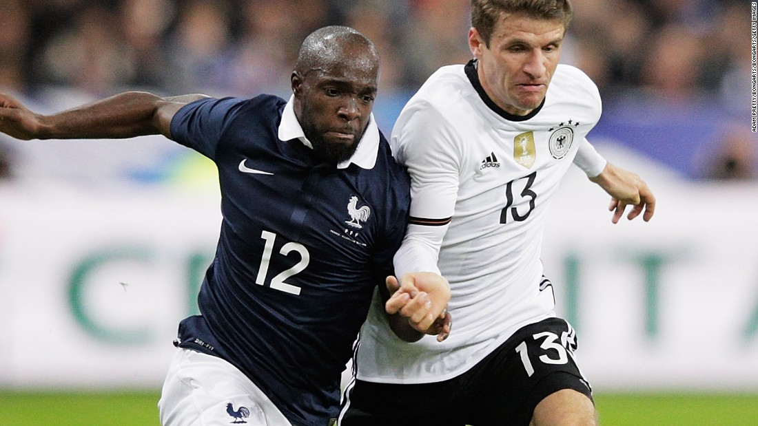 "French midfielder Lassana Diarra tussles with Germany's Thomas Mueller during Friday's match at the Stade de France. Diarra later revealed that his cousin had been a victim of the attacks in the French capital. <br />""She was like a big sister to me,"" the 30 year-old said."