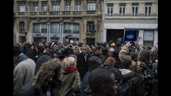 Bernard-Henri Levy, a prominent French philosopher, stands in the center of a crowd near the Bataclan on November 14.