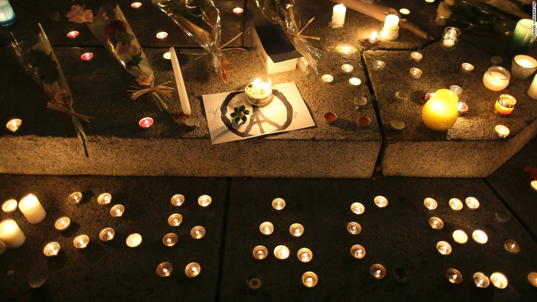 "Candles read ""peace"" at a temporary memorial for the victims of the Paris attacks in Rennes, western France."