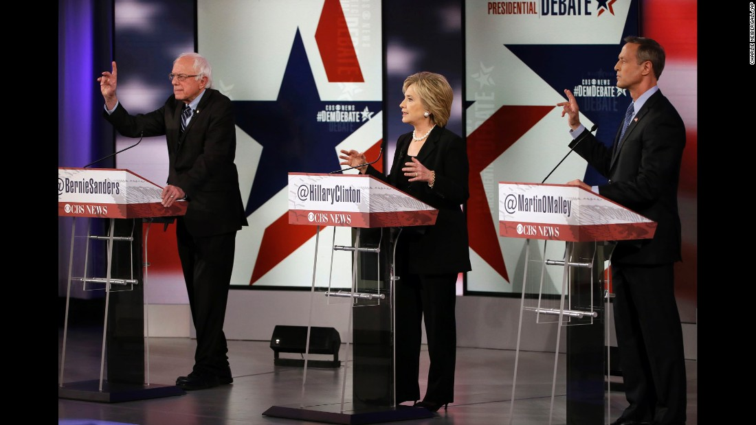 The candidates gesture during the debate.