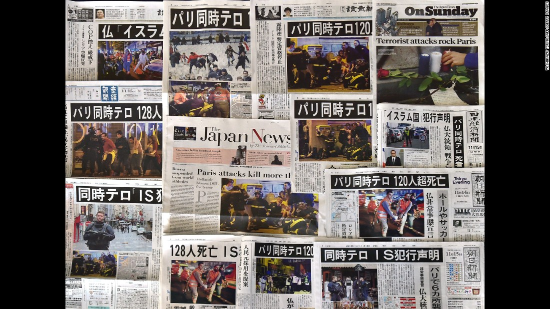 Front pages of Japanese newspapers in Tokyo show coverage and photos of the Paris attacks on November 14.