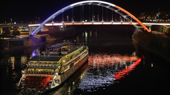 A paddlewheel riverboat passes under a bridge in Nashville, Tennessee, on Saturday, November 14.