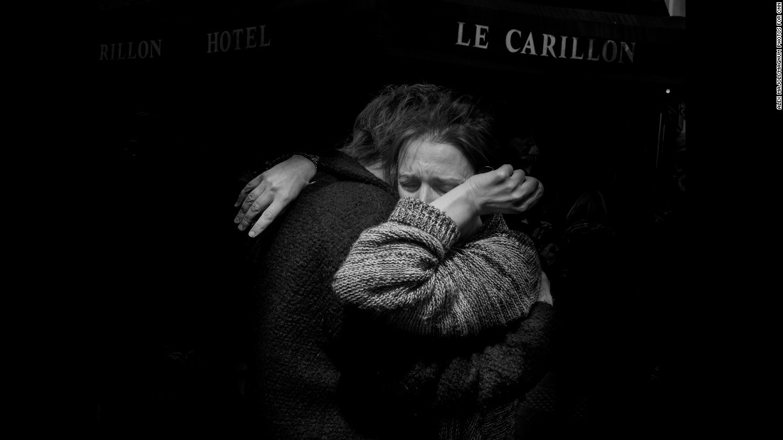 "The day after the terror attacks in Paris on Friday, November 13, Magnum photographer Alex Majoli photographed the range of responses to the tragedy. This image of two people embracing and crying in front of Le Carillon, the bar where gunmen drove by and opened fire with Kalashnikov-type assault rifles, is especially important to him. ""Many times when I come to Paris ... that is the bar where usually I have my last drink before I go to bed,"" Majoli said.<br />"