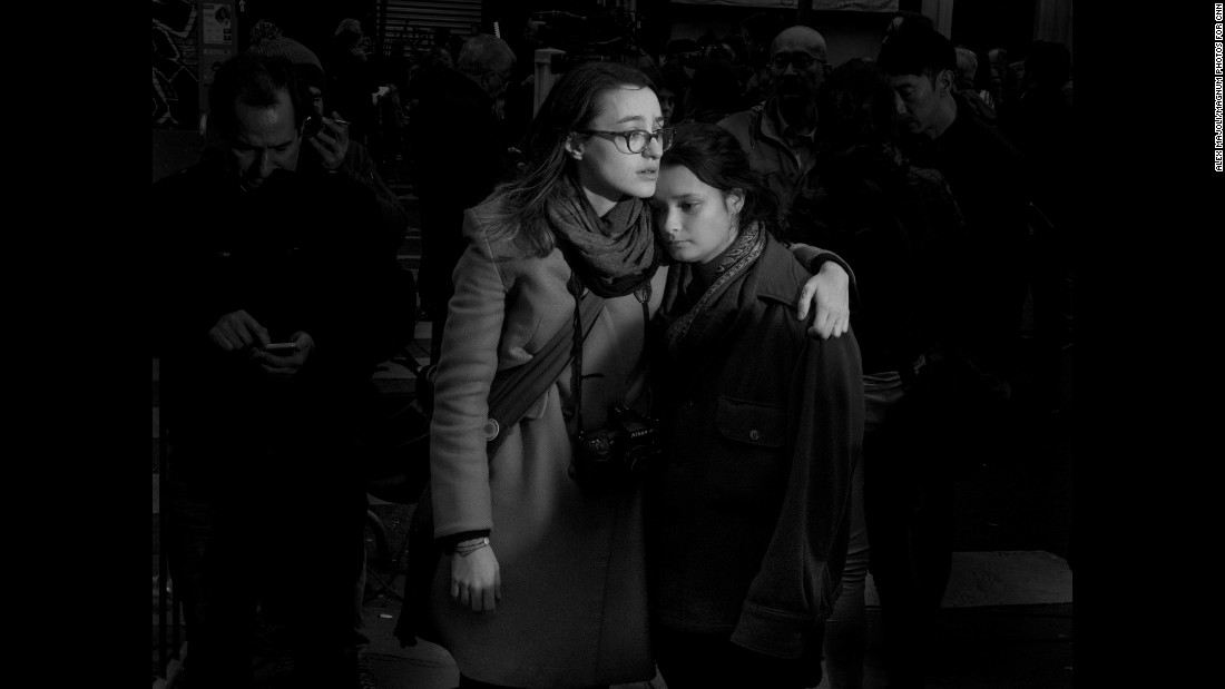 Two girls stand in front of the Bataclan music venue where men with AK-47 assault rifles opened fire. Majoli was with a friend just two blocks away from the Bataclan the night of the attacks. <br />
