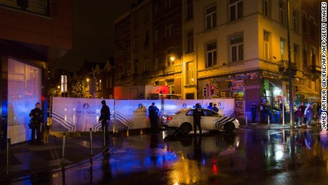 "Belgian police cordon off a street during a police raid in connection with the November 13 deadly attacks in Paris, in Brussels' Molenbeek district on November 14, 2015. Several people were arrested in Brussels on November 14 during police raids connected to the attacks in Paris, Belgian Justice Minister Koen Geens said. Geens said on RTBF television that these arrests in the capital's Molenbeek neighbourhood ""can be seen in connection with a grey Polo car rented in Belgium"" found near the concert hall in the French capital where scores of people were killed. AFP PHOTO / BELGA / JAMES ARTHUR GEKIERE = BELGIUM OUT =        (Photo credit should read JAMES ARTHUR GEKIERE/AFP/Getty Images)"