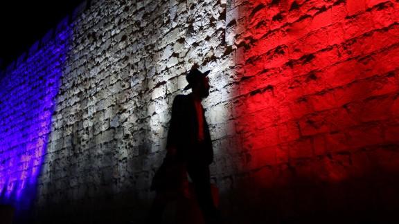 A man walks past Jerusalem