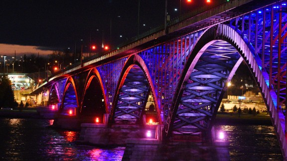The Peace Bridge, which connects Canada and the United States, glows with the colors of the French flag November 14 in Buffalo, New York.