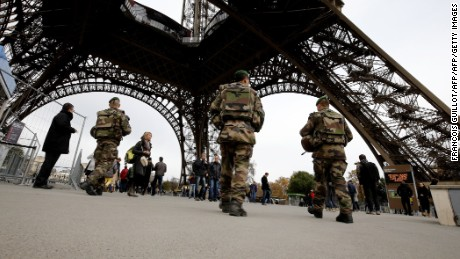 "French soldiers patrol the area at the foot of the Eiffel Tower in Paris on November 14, 2015 following a series of coordinated attacks in and around Paris late Friday which left more than 120 people dead.    French President Francois Hollande blamed the Islamic State group for the attacks in Paris that left at least 128 dead, calling them an ""act of war"". The multiple attacks across the city late Friday were ""an act of war... committed by a terrorist army, the Islamic State, against France, against... what we are, a free country,"" Hollande said. AFP PHOTO / FRANCOIS GUILLOT        (Photo credit should read FRANCOIS GUILLOT/AFP/Getty Images)"