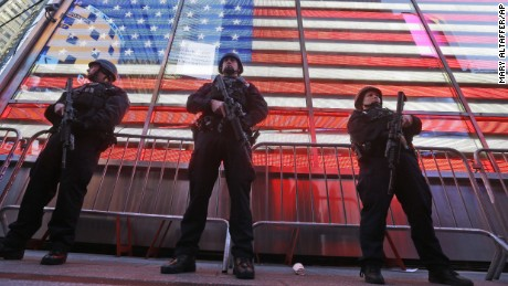 "Heavily armed New York city police officers with the Strategic Response Group stand guard at the armed forces recruiting center in New York's Times Square, Saturday, Nov. 14, 2015.  Police in New York say they've deployed extra units to crowded areas of the city ""out of an abundance of caution"" in the wake of the attacks in Paris, France. A New York Police Department statement released Friday stressed police have ""no indication that the attack has any nexus to New York City."" (AP Photo/Mary Altaffer)"