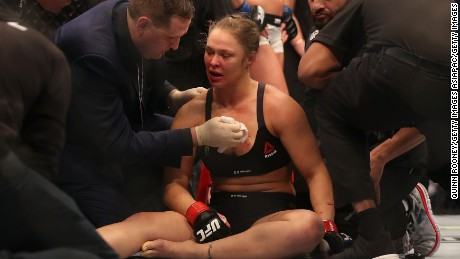 Rousey receives medical treatment after being knocked cold by Holly Holm.