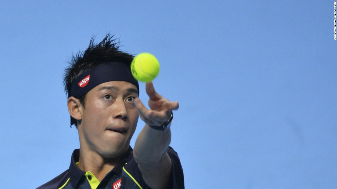 Nishikori throws the ball to serve during Sunday's match with Djokovic.