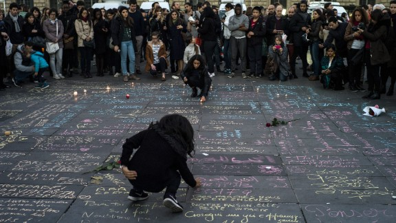 People write messages on the ground at Place de la Republique in Paris on November 15.