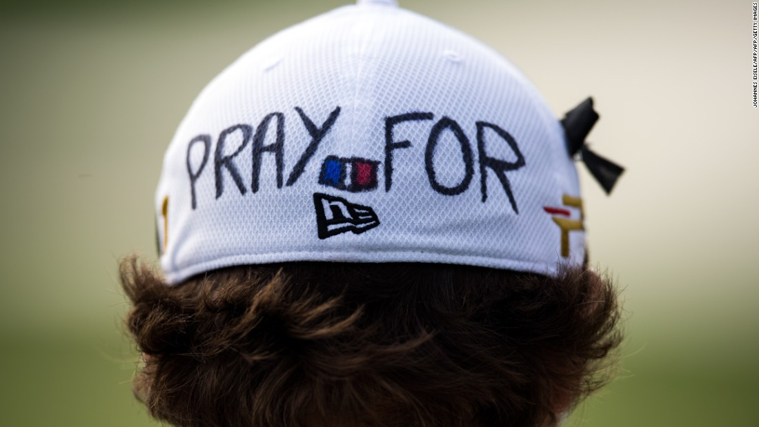 "Benjamin Herbert of France wears a cap which reads ""pray for Paris""  to commemorate the victims of Friday's attacks in the French capital during the Shanghai Masters golf tournament. The world of sport was united in sending a message of solidarity to Paris in its hour of need this weekend."