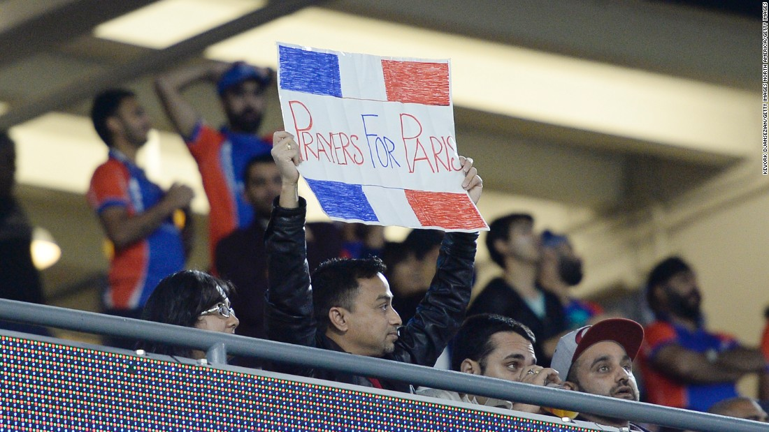 A fan holds up a sign in honor of the victims at the US tour of Cricket All-Stars Series.