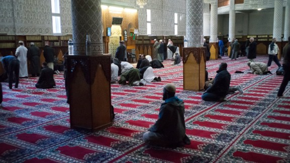 Men pray at the Courcouronnes mosque (Mosquee Evry Courcouronnes).