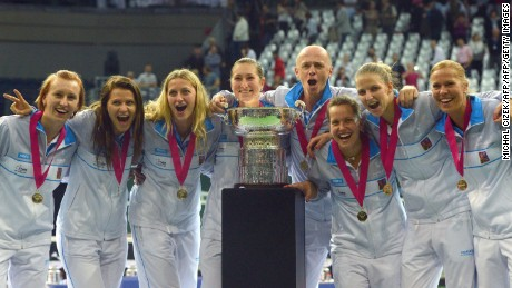 The Czech Republic's Fed Cup team players pose with the trophy after their triumph over Russia in Prague.