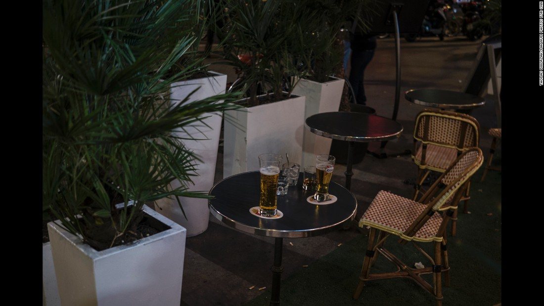 Drinks sit abandoned on a cafe terrace near Place de la République after a false alarm caused a panic on November 15.