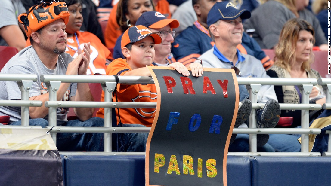 A young fan displays a sign NFL match between the Chicago Bears and the St. Louis Rams at the Edward Jones Dome on Sunday.
