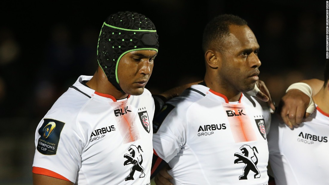 An emotional Toulouse and France rugby captain Thierry Dusautoir (L) lines up with his team for a minutes silence during the European Rugby Champions Cup match between Saracens and Toulouse at the Allianz Stadium in Barnet, England.
