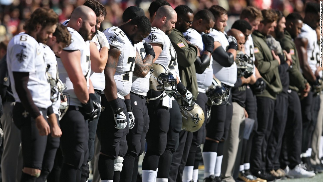 New Orleans Saints players fall silent before playing the Washington Redskins at FedExField, Maryland.