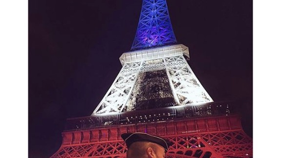 Eiffel Tower lights up with the colors of France