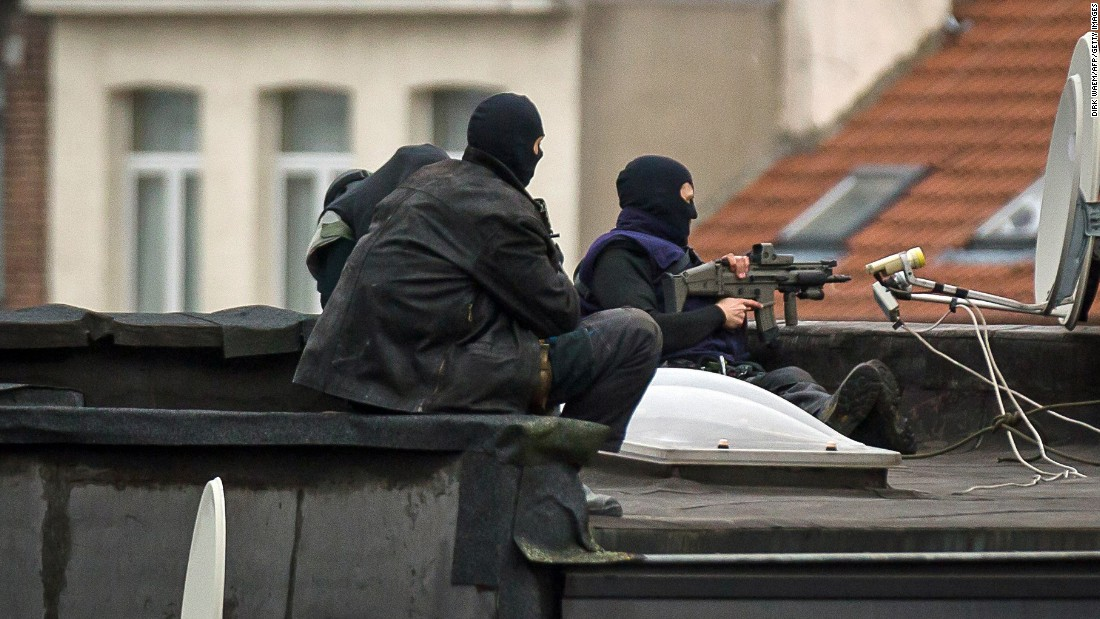 Special forces stand guard on a roof in Molenbeek, a suburb of Brussels, Belgium, on Monday, November 16.