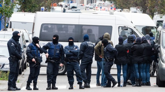 Armed police guard a street in Brussels on November 16.