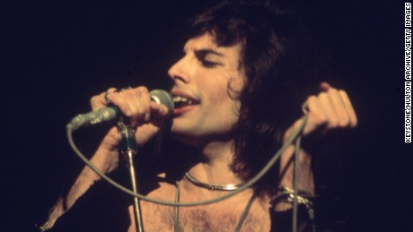 circa 1975:  Freddie Mercury (1946 - 1991), lead singer of 70s hard rock quartet Queen, in concert during the group's British tour.