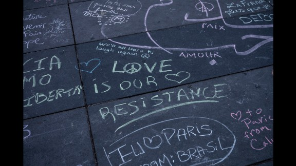 Comments made with different colored chalk are written on the Place de la Republique in Paris on November 16.
