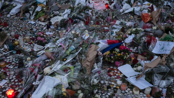 A memorial commemorates the victims of the Paris attacks on a street in Paris, France on Monday, November 16.
