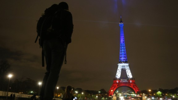 A photo taken on November 16, 2015 in Paris shows the Eiffel Tower illuminated with the colors of the French flag, in tribute to the victims of the November 13 Paris terror attacks. Islamic State jihadists claimed a series of coordinated attacks by gunmen and suicide bombers in Paris that killed at least 129 people in scenes of carnage at a concert hall, restaurants and the national stadium. AFP PHOTO / LUDOVIC MARIN        (Photo credit should read LUDOVIC MARIN/AFP/Getty Images)