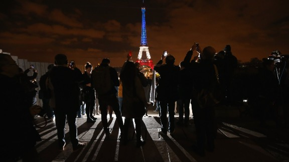 The Eiffel Tower is illuminated in Red, White and Blue in honour of the victims of Friday