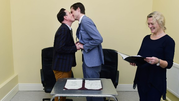 Richard Dowling, left, and Cormac Gollogly kiss after becoming the first same-sex couple to marry in Ireland on Tuesday, November 17.
