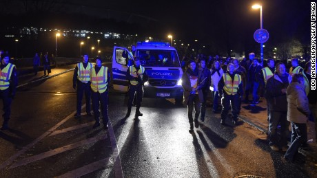 CORRECTING CITY Police secures the area as supporters leave the stadium after the friendly football match Germany vs the Netherlands was called off for 'security reasons' in Hannover on November 17, 2015.   AFP PHOTO / ODD ANDERSEN        (Photo credit should read ODD ANDERSEN/AFP/Getty Images)