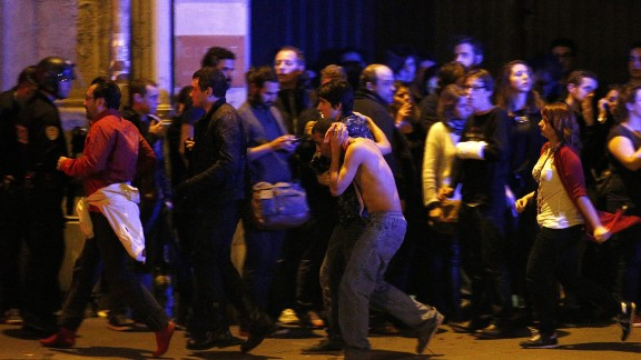 Wounded people are helped outside the Bataclan concert hall in Paris following a series of coordinated attacks in the city on Friday, November 13. The militant group ISIS claimed responsibility for the attacks, which killed at least 130 people and wounded hundreds more.