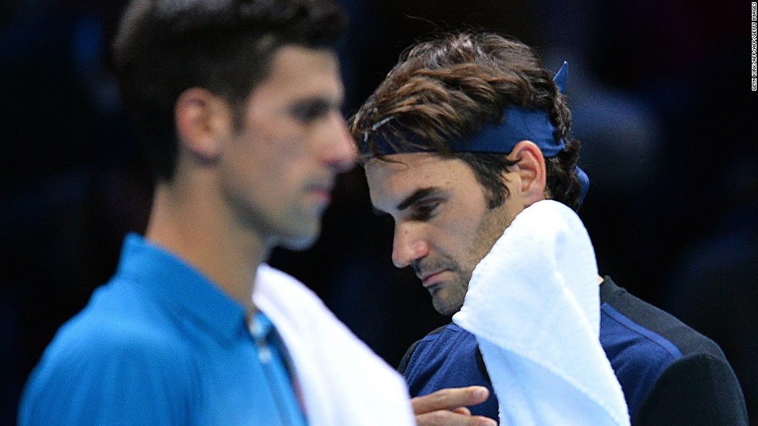 Novak Djokovic, left, and Roger Federer renewed their rivalry at the World Tour Finals on Tuesday.