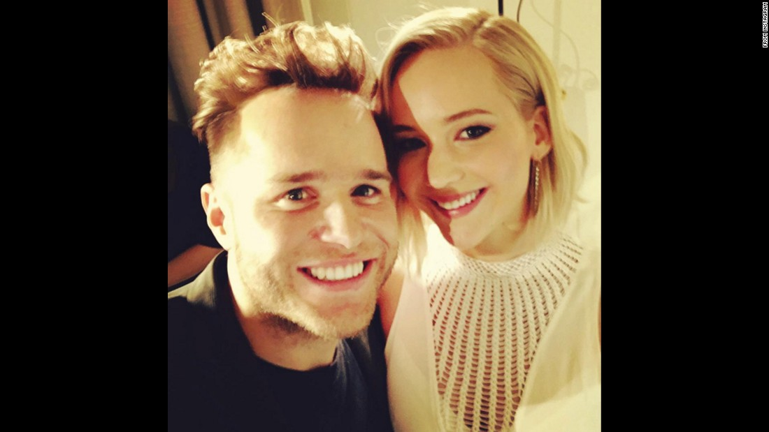 "Singer Olly Murs was able to get a selfie with actress Jennifer Lawrence after he helped interview her and her ""Hunger Games"" castmates for BBC Radio 1. ""Haha seriously need to go back to flirting school after meeting Miss Lawrence,"" <a href=""https://www.instagram.com/p/9-m3UZHyS7/"" target=""_blank"">he said on Instagram</a> on Thursday, November 12."