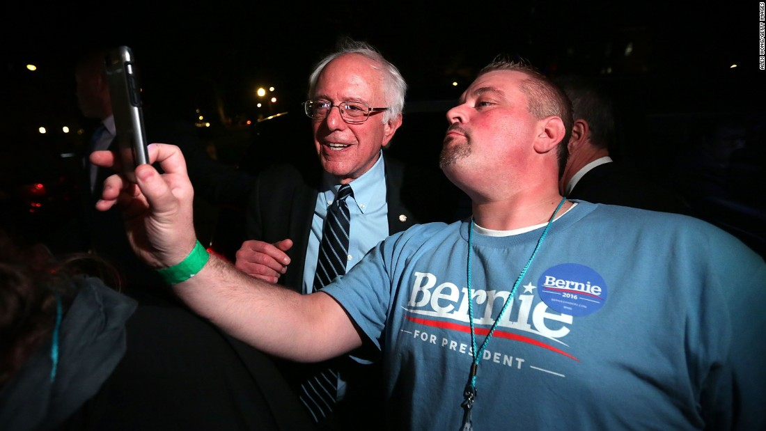 "U.S. Sen. Bernie Sanders, who is seeking the Democratic Party's presidential nomination, poses with a supporter in Des Moines, Iowa on Saturday, November 14. Des Moines was the location for <a href=""http://www.cnn.com/2015/11/15/politics/gallery/democratic-debate-iowa/index.html"" target=""_blank"">the second Democratic debate.</a>"
