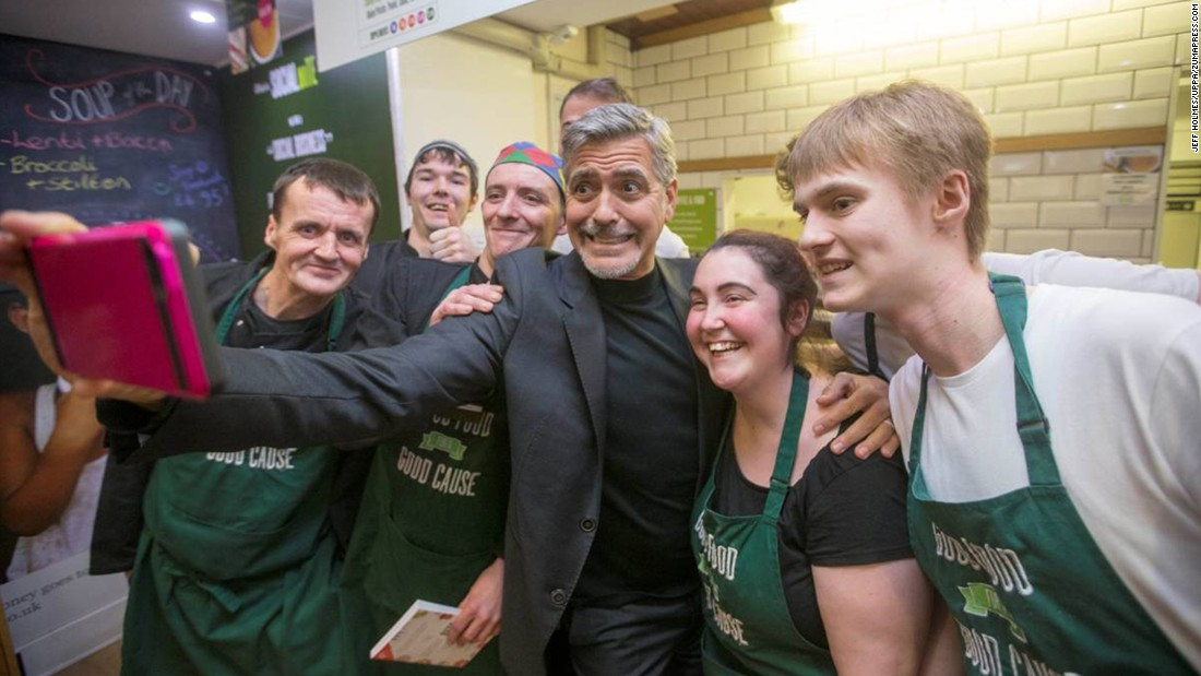 "Actor George Clooney takes a selfie with employees of a sandwich shop in Edinburgh, Scotland, on Thursday, November 12. The Social Bite Sandwich Shop and Cafe donates all its profits to charity, and it also allows customers to pay for items that a homeless person will receive later. Clooney donated 1,000 pounds ($1522), <a href=""http://www.theguardian.com/film/2015/nov/12/george-clooney-visit-edinburgh-social-bites-cafe-helps-homeless-people"" target=""_blank"">according to the Guardian.</a>"