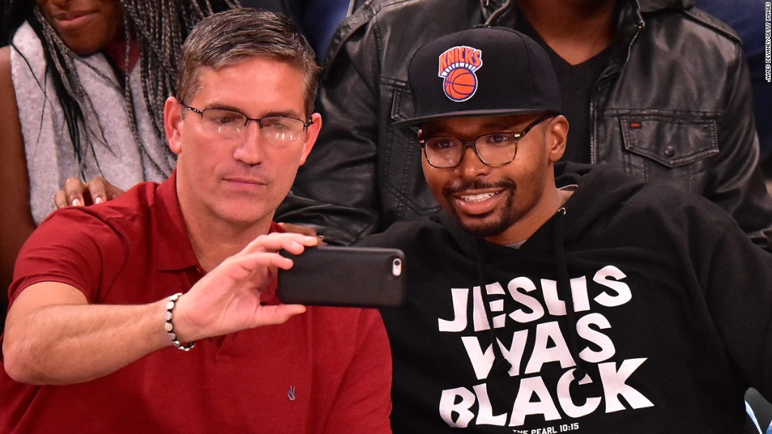 "Jim Caviezel, who played Jesus Christ in the 2004 film ""The Passion of the Christ,"" takes a selfie with a fan wearing a ""Jesus was black"" sweatshirt on Sunday, November 15. They were attending an NBA basketball game in New York."